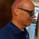Denis Green looks great with his pink ribbon