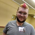 staff member Dakota just got his pink hair