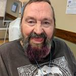 Resident, James Briss is excited about his pink beard! We love it too!